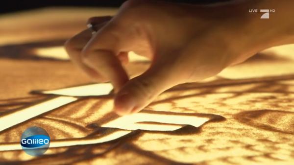 Sandmalerei Bedeutung unserer Alltagssymbole