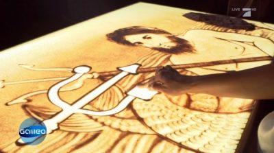 Sandmalerei Galileo Bedeutung unserer Alltagssymbole